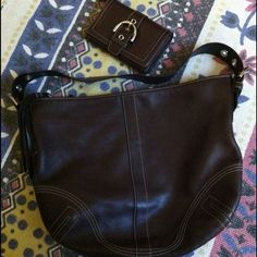 Coach brown leather hobo w matching wallet This is a classic Coach purse w matching wallet. Both in great shape. No nicks or scratches on the leather. The wallet has credit cards slots, coin zip and 2 interior pockets. A great set! Coach Bags Hobos