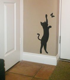 Cat catching butterfly wall art sticker