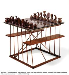 DESIGN ARCHIVE [after scandinavian collectors]-MAX ERNST, Chess Set and Board, 1944 (prototype). Material stained wood, glass and mixed media on paper. Wooden table stand by Xenia Cage / Study Blue Modern Chess Set, Chess Set Unique, Wooden Board Games, Vintage Board Games, Dragon Chess, Chess Table, Classic Board Games, Max Ernst, Chess Pieces