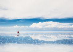 A cyclist crossing Bolivia's Salar de Uyuni salt flats © Olga_Gavrilova / Getty Images