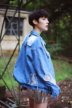 Oversized denim ripped jacket with silver shorts
