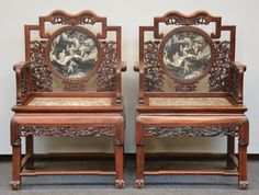Pair of Chinese hardwood armchairs with relief decorations of dragons and marble seat, the back polychrome decorated in ivory and lacquer, ca. 1900, H 106,5 - W 69 cm.