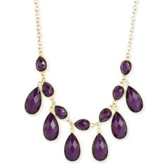 Gold Necklace with Faceted Purple Teardrop Drape.