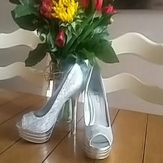 Silver sequin Shi by journeys heels Super comfy heels true to size sparkle heels. Comfortable height and easy ti walk in. Slight signs of wear still great condition. Shi by Journeys Shoes Heels