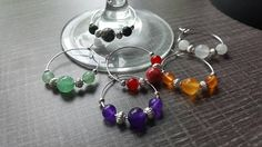 Set of 6 markers for wine glasses with different gemstones. Organza Bags, Wine Glass, Jade, Drop Earrings, Gemstones, Glasses, Bracelets, Silver, Jewelry