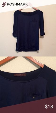 The Limited Navy Blue Top Navy blue boat neck top. Nautical style. Really soft. Silky in the front and soft lightweight material in back. Pocket in front with button and buttons at the quarter length sleeves. Slightly longer in the back. The Limited Tops
