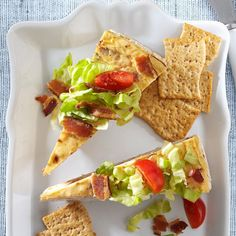 Savory BLT Cheesecake Recipe -Did you know that cheesecake could be savory instead of sweet? Tomato and green onions mixed with cream cheese is like an irresistible form of gazpacho. Served on lettuce, the BLT version is great on its own, but it's also a tasty appetizer when served with crackers. This is a flexible recipe, so use other cheese in place of the Gruyere, and add olives, crab meat, cooked mushrooms - whatever strikes your fancy. —Joni Hilton, Rocklin, California