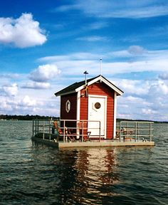 Hotel Utter Inn, Sweden: At first glance, this one-room hotel appears to be a cheery red house in the middle of the lake. But don't be fooled: Your room isn't actually in the house; it's 10 feet underwater. Hotel No Lago, Hotel Subaquático, Lake Hotel, Underwater Hotel Room, Underwater Theme, The Places Youll Go, Places To Go, Sleep With The Fishes, Floating Hotel