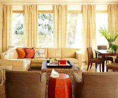 Buttercream and pumpkin hues make for an ultra cozy living room. More fall decorating ideas: http://www.bhg.com/decorating/color/schemes/cozy-color-schemes-for-every-room/