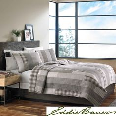 This soothing grey and white patchwork quilt from Eddie Bauer features a soft and comfortable 100-percent cotton cover and backing. With at least one included sham, the set is available in twin, full/queen and king quilt sizes.
