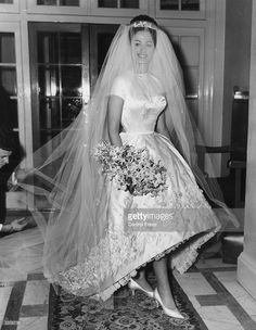 13th December 1960: Actress and author Jackie Collins celebrates her marriage to businessman Austin Wallace at Grosvenor House in London after a registry office ceremony. Her white satin wedding dress with intricate beading