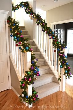 Christmas Staircase-lighted garland and ornaments. I want to do this but above my kitchen cupboards!