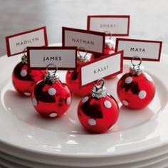 Christmas Wedding place cards... What a cute way to bring Christmas elements into your wedding. #LoveIt. Follow #Labola.co.za for more great tips and trends on Christmas wedding wonderlands. #LabolaLovesChristmas