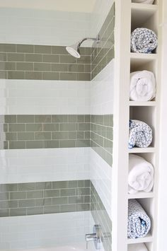 Cheap & fun shower tile idea: wide subway tile stripes! Plus towel cubbies for storage.