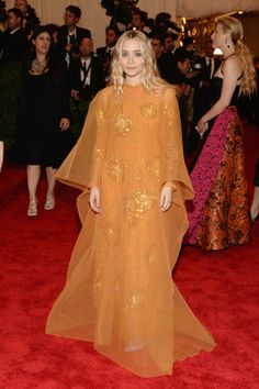 Ashley Olsen lit up the red carpet at the 2013 Met Gala in an orange vintage Dior gown.