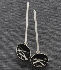 """Carla Pennie McBride: , Earrings in sterling silver, resin and black ink on Japanese paper. Approx 2.5"""" long."""