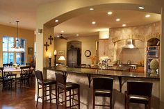 If I have to have a support wall between kitchen and great room; I would go this way with a arch above the island/bar - Kitchen Decor Magazine New Kitchen, Kitchen Decor, Kitchen Design, Room Kitchen, Dining Room, Awesome Kitchen, Cheap Kitchen, Beautiful Kitchen, Rustic Kitchen
