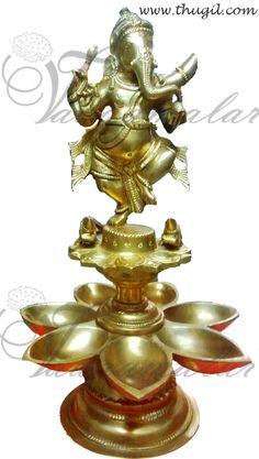 Handmade Ganesha in Brass with lamp decorations  http://www.thugil.com/standing-ganesha-brass.html