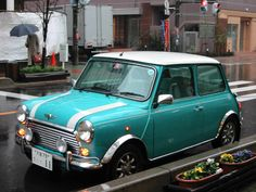 My first car was a lil MINI! It was a fun lil car at the time :) Classic Mini Cooper