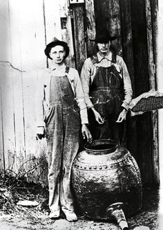 Charlie and Willie Hall with their moonshine still Clay County, Tennessee, ca. late 1920s