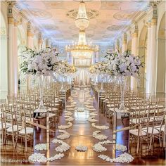 Photo: Absolutely stunning gold and white wedding aisle by Elly B Events , Photo by Milanes Photography and Flowers by Andy Beach & Co.