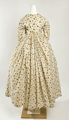 Dress Date: 1797–98 Culture: French Medium: Cotton Dimensions: a) L. at center back: 10 in. (25.4 cm) b) L. at center back: 35 1/2 in. (90.2 cm)