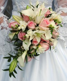 wedding bouquet with lilies and roses | ... bouquet of white stargazer lilies, white calla lilies and pink roses