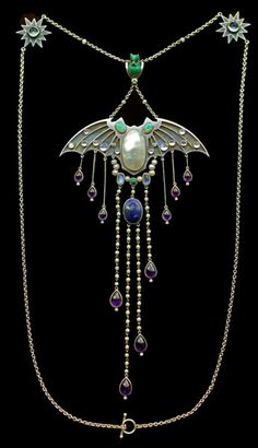 talisman:  Georg Kleemann - Jugendstil bat pendant necklace. Made of Silver, gold, opal, enamel, moonstone, pearl, amethyst, lapis, turquoise, ruby & diamond. Circa 1900.