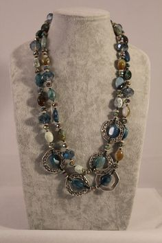 Teach your old clothes a new trick.  This long necklace is made with blue agates and crystals mixed with hammered metal as accents all knotted with blue silk thread.      The bright blue stones, adds shine and is the perfect pop of color to any dress.  You can wrap around your neck two or three t...