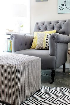 Couch slipcover color and rug upholstered herringbone ottoman + tufted nailhead club chair + mixed patterns Living Room Grey, Formal Living Rooms, Home And Living, Living Room Inspiration, Home Decor Inspiration, Mellow Yellow, Gray Yellow, Black White, Up House