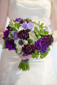 Purple, lavender, green and white bridal bouquet with freesia, lisianthus, anemones, mint, roses and scabiosa © http://www.MoscaPhoto.com