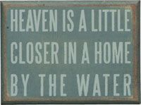 Heaven is a little closer in a home by the water.