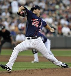 Minnesota Twins' Scott Diamond pitches against the Cleveland Indians in the first inning of a baseball game on Friday, July 27, 2012, in Minneapolis