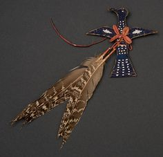Apsáalooke (Crow) charm made from tanned hide, glass beads, pigments, and sage grouse feathers, ca. 1900. Paul Dyck Plains Indian Buffalo Culture Collection. NA.502.345