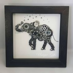 Steampunk Elephant Button Art Frame  Black natural wood frame 6 × 6 in / 15 × 15 cm with a cream background.  Handmade, using buttons and acrylic gemstones.   £25 plus postage & packaging  https://www.etsy.com/uk/shop/UniqueGiftsButtons https://www.facebook.com/unique.gifts.buttons
