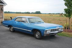 my 1st car was a 67 Chevy Impala 4-door(like this) but cream color w/black interior