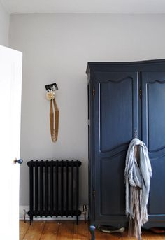 Wardrobe painted in Farrow & Ball's Off Black - interesting it has such a blue reflection