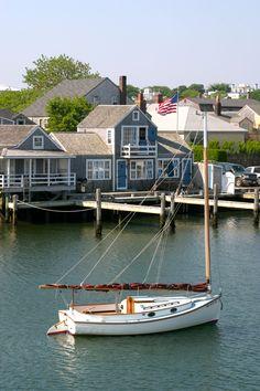 (Nantucket harbor)  catboat on a hook.