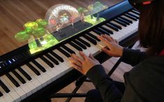 Students from Carnegie Mellon University's Entertainment Technology Center have been working on an augmented reality system to help teach music in a project called Music Everywhere. This application for the Microsoft HoloLens would utilize holograms to visually instruct the user and teach them how to play an instrument in the process. Music Everywhere would also have a virtual band that the wearer could play along with as well as see. The team developing this project is made up of Seth Gl...