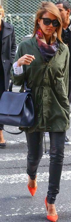 Who made  Jessica Alba's orange suede pumps, green parka coat, and blue handbag?