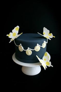 Navy with white & yellow butterflies