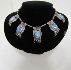 Sterling Silver Festoon style necklace Sapphire cup set stones a lovely piece.Ca. 1900- 1910
