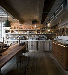 Pizza East  designed by   Michelis Boyd    with respect to the old industrial building roots; exposed concrete beams, brick work and p...