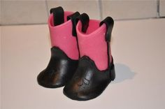 Fabulous picture tutorials.  They show them for fondant but I think clay baby shoes for a baby shower would be great!