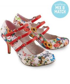 These quirky heels have a floral fabric with a delicate pink polka dot lining and unique triple strap.