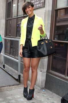 Frankie Sandford Blazer - Frankie Sandford add a dash of color to her black romper when she paired it with this neon yellow blazer.