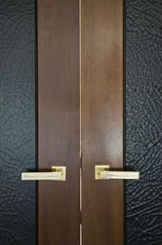 leather and wood door. Leather panels for inside panel of door. Favorite doors of www.andrearodman.com  A Vancouver based Interior Design Firm.