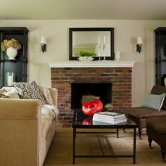 Living rooms with red brick fireplaces