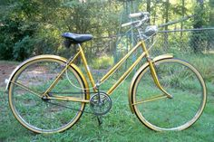 """RALEIGH /""""Raleigh Sports Model/"""" gold block in gold frame."""