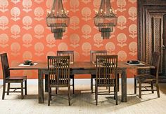 Elegance Defined: A minimalist design can still be high-impact - just look at this show-stopping dining room. Tiffany Dining Table, $1,549. Wallpaper Schumacher Ottoman Flower Paprika 5005083